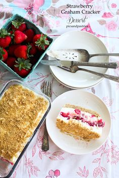 A graham cracker crust topped with a whipping cream and marshmallow mixture, then topped with fresh strawberries more cream and a thin layer of graham cracker crumbs.