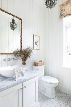 Chic white cottage bathroom boasts vertical white shiplap walls accented with a gold ornate mirror above a white shaker vanity fitted with a gray marble countertop holding an oval bowl sink beneath a wall mount polished nickel vintage faucet. Shiplap Bathroom Wall, Bathroom Wall Decor, Bathroom Canvas, Bath Decor, Funny Bathroom, Bathroom Ideas, Bathroom Fixtures, Modern Bathroom, Bathroom Lighting