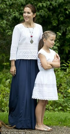 The 43-year-old Crown Princess wore a white eyelet top with a flowing maxi skirt...