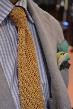 vintage orange colored tie, blue stipped shirt, and light gray jacket... Fantastic!