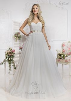 O rochie de mireasa stil printesa cu decolteu in forma de inima care iti va pune in valoare frumusetea naturala.