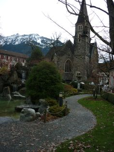 Old Stone Church In The City Of Interlaaken: This photo was taken in November 09 when a friend and I visited parts of Switzerland and Italy. I recall this scene appearing quite surreal to me as we came upon it, and quickly captured it with my camera. #travel