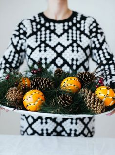 DIY an orange clove centerpiece to decorate your home for the holidays with this easy project.