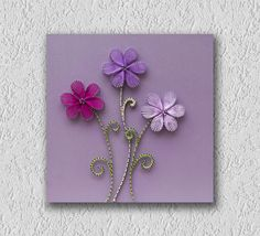 This one is a cute string art painting that I like to call Three little flowers. I use acrylic colors on wood, some nails, some strings and a 13.8x13.8