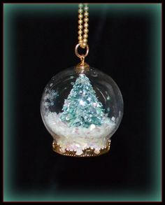 """Tiny Wearable Christmas Tree Snow Globe Necklace 1"""" Tall Pendant Women's Jewelry A beautiful & unique gift. http://tophatter.com/lots/10370064?ref=245730 #snowglobe #necklace #christmas tree Buy it now on Tophatter.com and you can save $10 with my instant credit Promo Code enter 4bfe2"""