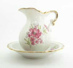 Porcelain pitcher and wash basin bowl set with pink flowers and gold-trim scalloped edge