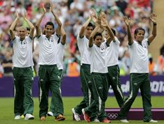Mexico's players arrive for the medal ceremony after defeating Brazil in their men's soccer final gold medal match at Wembley Stadium during the London 2012 Olympic Games August 11, 2012.