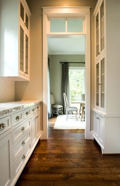 This Euro-Cut White Oak floor was custom made at Mason's Mill & Lumber. a walnut stain was applied to create a beuatiful color contrast on the white hardwood cabinets