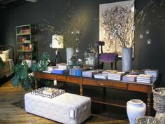 """the 'library table' look inside jayson home's chicago store--we have something similar  at home on our dining table. Except we call it our """"What the hell is all this mess?"""" look."""