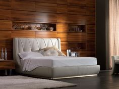 Upholstered leather storage bed with upholstered headboard ELETTRA Night Collection by Cantiero