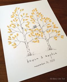 New Design, Discounted, Twin Aspen Design, The original hand-drawn wedding guest book fingerprint tree (ink pads sold separately). $60.00, via Etsy.