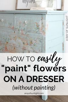 Learn how to paint flowers on furniture without a paint brush or paint! These transfers are easy to use and they can go on any type of furniture or decor! Peel and stick foral transfers onto a dresser! I love these pink flowers on the blue painted dresser!