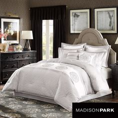 A white horizontal stripe runs through the middle of the Belmont comforter with a circular damask motif drawing attention to this beautiful soft gray quilted comforter. The gray border running alongside the white strip creates a slight sheen.