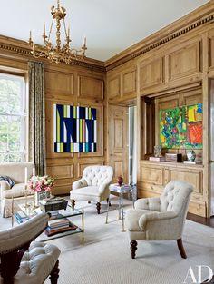 Works by Sarah Morris (left) and Hofmann enliven the oak-paneled library.