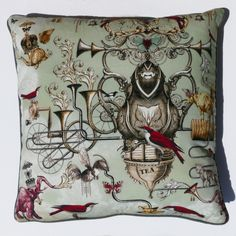 PERFECT CUPPA KETTLE GREEN CUSHION – The surreal illustrations in this design really show off the talents of Joseph Alexander Goode. The exotic birds and trumpeting elephants are delightful.   See more of our amazing range at www.inspirehomeproducts.co.uk #interiordesign #home #cushion #green #style