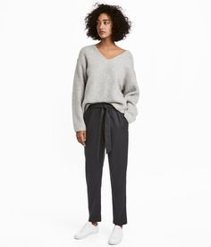 Check this out! Loose-fit pants in stretch twill with a removable tie belt. Elasticized waistband with ruffle trim, side pockets, dropped gusset, and tapered legs. - Visit hm.com to see more.
