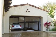 Custom car lift in California garage - mediterranean - garage and shed - los angeles - McKinley Elevator Corporation Home Car Lift, 4 Post Car Lift, Garage Car Lift, Dream Garage, Garage Gate, Garage Shop, Car Lifter, Hydraulic Car Lift, Car Hoist