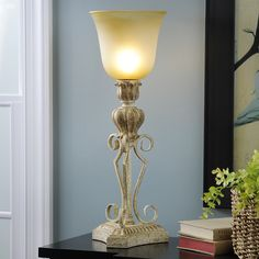The vintage gold finish and detailed base of the Marsails Vintage Gold Uplight makes it a beautiful addition to any home!