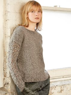 D'Arcy - Knit this ladies long sleeved sweater from Rowan Knitting & Crochet Magazine 58, a design by Marie Wallin using the beautiful yarn Fazed Tweed (wool, alpaca and polyamide.) With the main body of the sweater knitted in stocking stitch and pretty crocheted lace sleeves, this knitting pattern is suitable for the average knitter/crocheter.