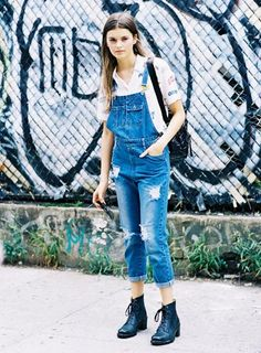 Add a graphic printed collared shirt to distressed overalls and combat boots for the ultimate cool girl look.