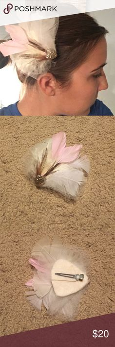 Vintage Feather Hair Piece This beautiful vintage feather hair piece brings old-fashioned glam to any outfit! Mostly white feathers with 2 baby pink for accent. Also has white netting and a gold heart. Clips into hair. Excellent condition! Vintage Accessories Hair Accessories