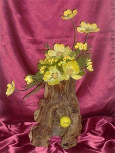 Yellow flowers in wood centerpiece : Unusual flowers design in unique grape wood design.