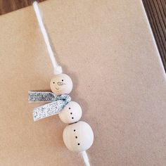 beaded yarn snowman #giftwrap