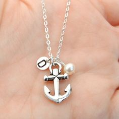 Hey, I found this really awesome Etsy listing at http://www.etsy.com/listing/123610520/silver-anchor-necklace-pearl