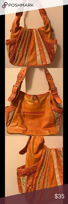 Orange purse The color is amazing!! Great detail & lots of places to keep all your essentials. Looks like a $200 purse. Shows just a little wear. Bags