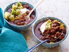 Bobby's Beef and Black Bean Chili with Toasted Cumin Crema and Avocado Relish : Pack intense flavor into one spoonful with a variety of peppers. Bobby's stick-to-your-ribs chili is chock-full of spicy beef chunks and canned tomatoes (they're the most consistent to work with). Cool off your mouth with a scoop of Mexican crema and avocado topping.