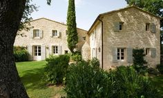 Villa in Provence | Inspiring Interiors....limestone, white windows, gray shutters and brown accents