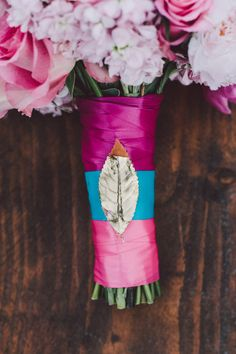 hot pink, blue, and fuchsia wrapped bouquet // photo by Leo Evidente // flowers by These Buds a Blooming