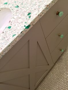 Recycled glass countertop, Rockport Gray vanity, penny tile.
