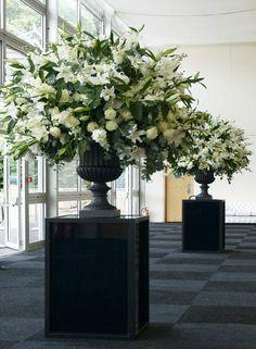 .classic elegance white flowers wedding ceremony urn arrangements