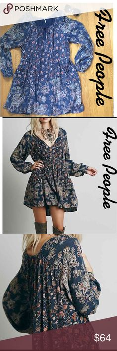 """Free People BOHO-Chic Floral Print Dress. Slip into easy style when you wear this frock from Free People. Pretty blooms and boho-chic sleeves add a cool vibe, too!  8"""" of small gathers at waist area center front and keyhole opening with string tie at neckline to add pretty details. Length 34"""". Keyhole area can be left open just for some big chunky necklace or simply tied with string tie. New in like new condition. BOHO-Chic. Free People Dresses"""