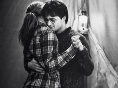 No, it wasn't in the book. Yes, I am a book purist. However, this scene helped show the strength of Harry and Hermione's friendship