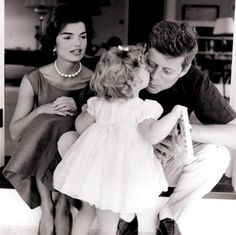 In this 1959 file photo, Caroline Kennedy kisses her father, then Senator John F. Kennedy, as her mother Jacqueline looks on, in their residence in Washington DC. Image from Jacqueline Kennedy's Audio Tapes: 'John John' Says 'He's Gone to Heaven'