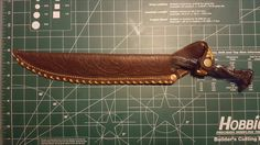 Custom hand-tooled knife case for smithed chefs knife.
