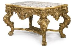 A LARGE RÉGENCE STYLE CARVED GILTWOOD CENTER TABLE Continental, second half 19th Century