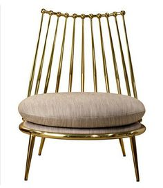 AURORA armchair from property furniture. Metal armchair with upholstered seat in fabric. Frame finishes: brass or copper.