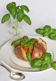 Baked potato with basil and a sundried tomato filling.