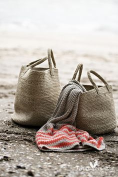 The perfect beach bag, floppy materials in natural colours.