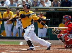 Pinch hitter Jake Fox #41 of the Pittsburgh Pirates hits a homerun against the Philadelphia Phillies during a Grapefruit League Spring Training Game at McKechnie Field