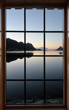 View through the window at the sunrise over the fjord - View through the window at the sunrise over the fjord
