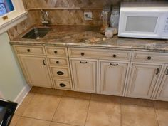 Prep sink and base cabinetry.