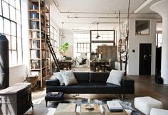 Designer and artist Alina Preciado designed her Brooklyn loft space with a mix of international and industrial furnishings, many of which she sourced on worldly travels related to her business, an imported goods company. This is one home for which I'd gladly cross the bridge.