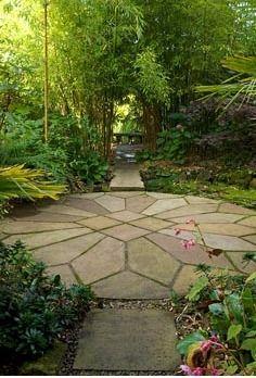 Circular patio terrace leading to a bamboo bench