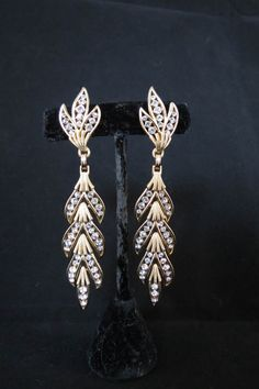 This is a great price on these earrings.. The earrings are an old vintage crown Trifari with the big open crown above the T..    They are