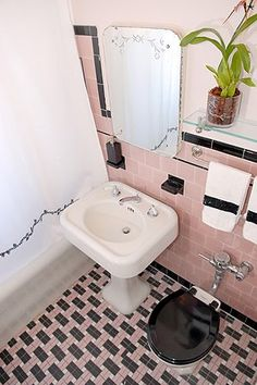 Retro, vintage style bathroom with pink tiles This totally reminds me of my gma and gpa's house - except I think theirs was a teal/mint bathroom design designs interior decorating before and after Black Tile Bathrooms, Pink Bathroom Tiles, Pink Tiles, Vintage Bathrooms, Small Bathroom, Pink Bathrooms, Modern Bathroom, Bathroom Ideas, Minimalist Bathroom