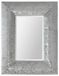 This stunning mirror is sure to be a showpiece in any décor with its chrome finish, hammered metal texture and rectangular beveled mirror.